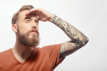 Handsome bearded man with hand at his fore head