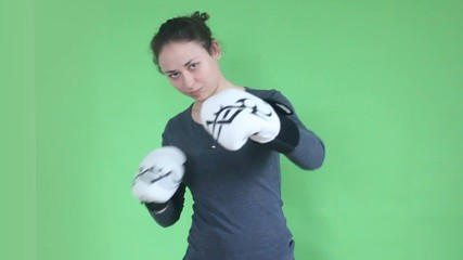 young girl boxing on green screen
