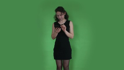 young girl writing sms green screen