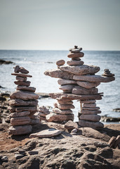 Two stacked stone cairns