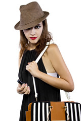 stylish woman looking for lipstick inside leather bag