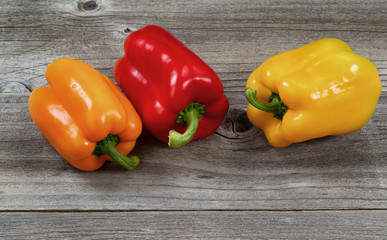 Healthy bell peppers on rustic wood