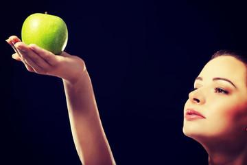 Beautiful woman holding an apple.