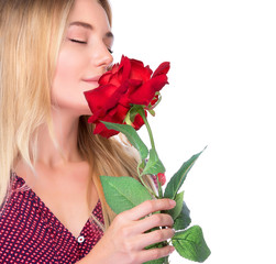 Woman smelling beautiful red rose