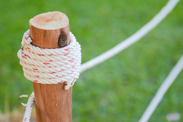 knot by rope on wood pole