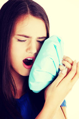 Young casual woman with toothache.