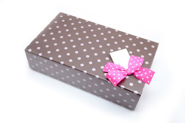 brown box with gifts and pink bow