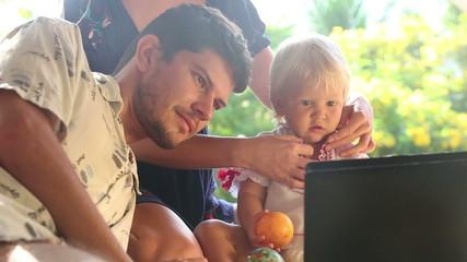 family watching cartoon on laptop