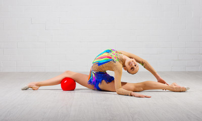 Girl is engaged in art gymnastics