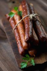 Stack of smoked sausages, close-up, selective focus, studio shot