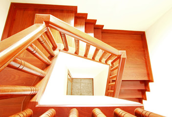 Interior work of wooden stairs and handrail