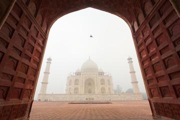 Framing of Taj Mahal mausoleum in a foggy morning
