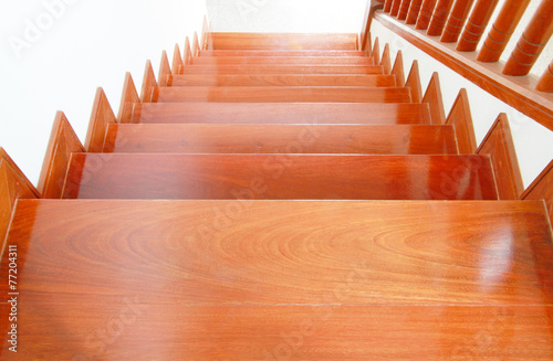 Interior work of wooden stairs and handrail - 77204311