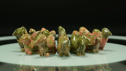 Rotating unakite carved rooster figurines