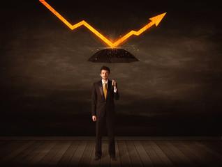 Businessman standing with umbrella keeping orange arrow