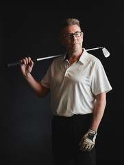 Mature man golfer and golf club