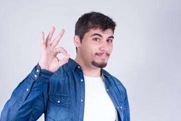 Man making the gesture OK