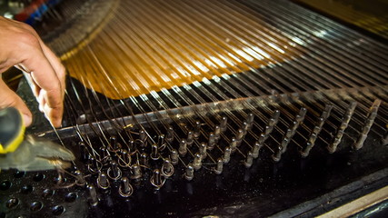 Disassembly Process of Old Piano Strings. Time lapse