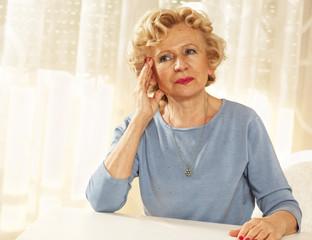 Senior woman with migraine problems.