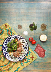 traditional central asia basturma with ingredients on uzbek fabr