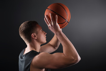 Caucasian male basketball player free throwing the ball