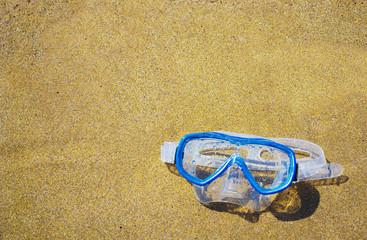 diving mask on a golden beach