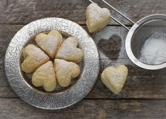 homemade biscuits in the form of hearts. shallow depth of field