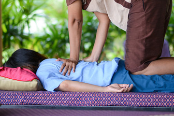 girl is relaxing from massage by professional therapists