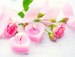 Valentines Day. Pink heart shaped candles and rose flowers