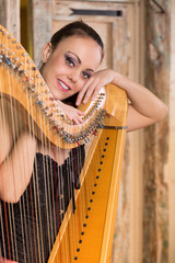 woman playing the harp