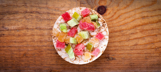 Rice waffle and dried fruit on wooden background