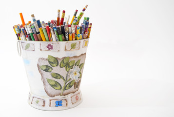 Color bucket with multicolor pencils, isolated on white