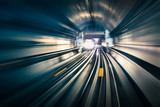 Subway tunnel with blurred light tracks with arriving train