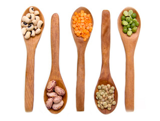 Vegetables on wooden spoons from above