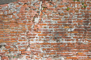Brick wall deeply cracked - concept image