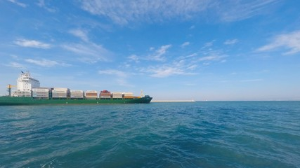 Container ship leaving port - Time lapse