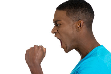 angry upset young man fists in air, open mouth yelling