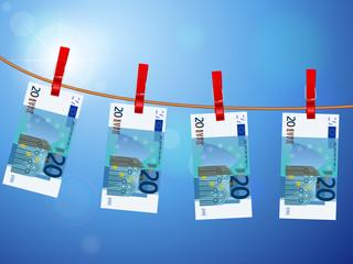 twenty euro banknotes on clothesline