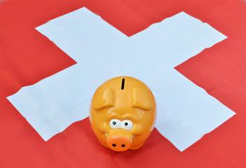 Piggy bank on the Swiss flag