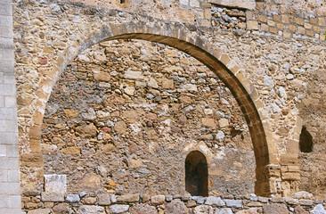 Stone ruins on the Greek aqueduct on island of Crete .