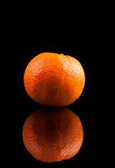 .Orange fruit isolated on a black background