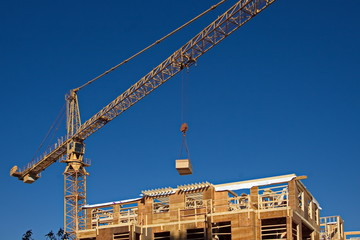 Construction crane delivers building material