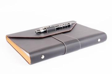 black luxury organizer with pen