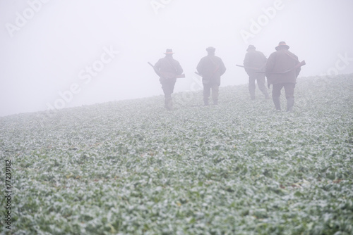 Foto op Aluminium Jacht Group of hunters in autumn mist.