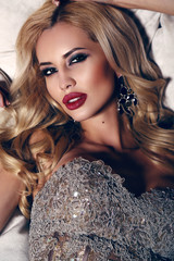 gorgeous woman with blond hair and bright makeup