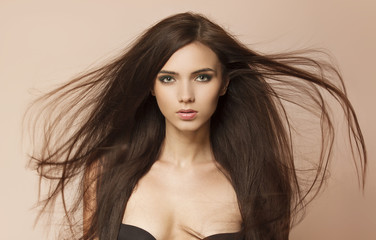 Beautiful woman with long healthy brown hair