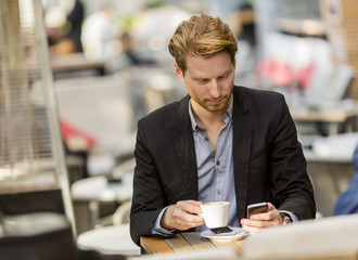 Young businessman in the cafe