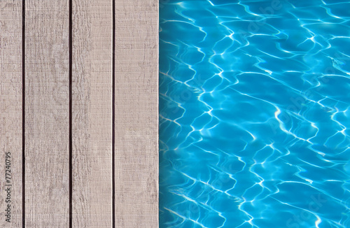 Swimming pool and wooden deck ideal for backgrounds - 77240795