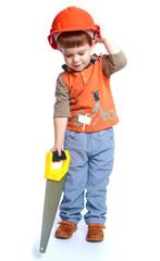 Little boy holding a hacksaw on wood.