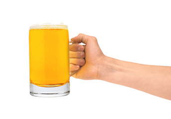 Glass of beer in man hand isolated on white